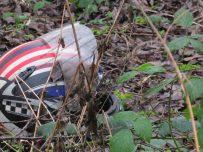 Discarded helmet on waste ground