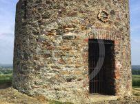 Round stone building atop Vinegar hill